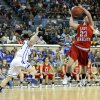 Erick\'s Shyli May shoots a lay up as Lomega\'s Kylie Turner defends during the Class B girls state championship between Erick and Lomega at the State Fair Arena., Saturday, March 2, 2013. Photo by Sarah Phipps, The Oklahoman