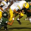 Putnam City West\'s Robert Endicott is tackled by Edmond Santa Fe players during the high school football game between Edmond Santa Fe and Putnam City West at Wantland Stadium in Edmond, Okla. on Friday, Oct. 5, 2007. By James Plumlee, The Oklahoman