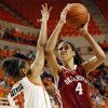 Oklahoma\'s Nicole Griffin (4) shoots against Oklahoma State\'s Kendra Suttles (31) during the Bedlam women\'s college basketball game between Oklahoma State University and the University of Oklahoma at Gallagher-Iba Arena in Stillwater, Okla., Saturday, Feb. 23, 2013. OSU beat OU, 83-62. Photo by Nate Billings, The Oklahoman