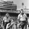 "Photo -  ""OU (college football) coaches Barry Switzer (kneeling), Wendell Mosley (left) and Bob Jones find the scene in the Cotton Bowl sometimes inspiring, sometimes depressing, and always engrossing."" Staff photo by Paul B. Southerland taken 10-11-80; photo ran in the 10-12-80 Daily Oklahoman."