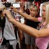 Nancy Reynolds and University of Oklahoma freshman daughter Morgan from Blue Springs, KS, look at shirts at Balfour on Campus Corner as shoppers enjoy a tax-free weekend in Norman, Okla. on Saturday, Aug. 8, 2009. Photo by Steve Sisney, The Oklahoman