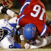 Stroud\'s Dalton Baade is brought down by Oklahoma Christian School\'s Duncan Aldridge during a high school football playoff game in Edmond, Friday, Nov. 23, 2012. Photo by Bryan Terry The Oklahoman