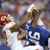 Photo - Indianapolis Colts' Da'Rick Rogers (16) makes a reception against Kansas City Chiefs' Sean Smith (27) during the second half of an NFL wild-card playoff football game Saturday, Jan. 4, 2014, in Indianapolis. (AP Photo/AJ Mast)