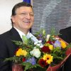 European Commission President Jose Manuel Barroso reacts, as he received flowers by Norway\'s ambassador to the EU Atle Leikvoll, after the 2012 Nobel Peace Prize was given to the EU, at the European Commission headquarters in Brussels, Friday, Oct. 12, 2012. The European Union won the Nobel Peace Prize on Friday for its efforts to promote peace and democracy in Europe, an award given even though the bloc is struggling with its biggest crisis since it was created in the 1950s. (AP Photo/Yves Logghe) ORG XMIT: YL107