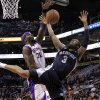 Memphis Grizzlies\' Wayne Ellington (3) has his shot blocked by Phoenix Suns\' Jermaine O\'Neal during the first half of an NBA basketball game on Wednesday, Dec. 12, 2012, in Phoenix. (AP Photo/Matt York)