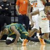 Oklahoma State \'s Marcus Smart (33) gets a steal on Baylor\'s Deuce Bello (14) during the college basketball game between the Oklahoma State University Cowboys (OSU) and the Baylor University Bears (BU) at Gallagher-Iba Arena on Wednesday, Feb. 5, 2013, in Stillwater, Okla. Photo by Chris Landsberger, The Oklahoman
