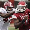 Photo -   Arkansas quarterback Brandon Mitchell, right, carries against Alabama linebacker Xzavier Dickson (47) during the first quarter of an NCAA college football game in Fayetteville, Ark., Saturday, Sept. 15, 2012. (AP Photo/Danny Johnston)