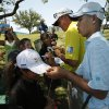 In this photo taken Tuesday, May 14, 2013, Guan Tianlang, 14, from China, and signs autographs with Matt Bettencourt sign autographs on the 17th hole during a practice round at Byron Nelson Championship golf tournament in Irving, Texas. (AP Photo/The Dallas Morning News, Brad Loper) MANDATORY CREDIT; MAGS OUT; TV OUT; INTERNET USE AP MEMBERS ONLY; NO SALES.