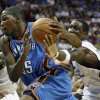 Oklahoma City Thunder forward Kevin Durant, left, drives to the basket as Orlando Magic forward Mickael Pietrus, of France, tries to steal the ball during the first half of an NBA basketball game in Orlando, Fla., Wednesday, Nov. 18, 2009. (AP Photo/John Raoux) ORG XMIT: DOA101