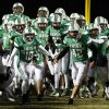 The Bishop McGuinness Fighting Irish take the field before a high school football game between Bishop McGuinness and Guthrie at Bishop McGuinness Catholic High School in Oklahoma City, Friday, Oct. 26, 2012. Photo by Nate Billings, The Oklahoman