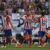 Atletico\'s Toby Alderweireld, center, celebrates his goal with teammates during a Spanish La Liga soccer match between Atletico Madrid and Malaga at the Vicente Calderon stadium in Madrid, Spain, Sunday May 11, 2014. (AP Photo/Gabriel Pecot)