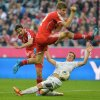 Photo - Bayern's Claudio Pizarro of Peru, left, scores during the German first division Bundesliga soccer match between FC Bayern Munich and SC Freiburg in Munich, Germany, on Saturday, Feb. 15, 2014. (AP Photo/Kerstin Joensson)