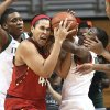 Photo - Miami's Maria Brown, left, and Jessica Thomas compete with Maryland's Brionna Jones (42) for the ball during the first half of an NCAA college basketball game in Coral Gables, Fla., Thursday, Feb. 13, 2014. Photo/J Pat Carter)