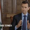 In this image taken from video filmed on Thursday, Feb. 28, 2013 and released Saturday evening, March 2, 2013, Syrian President Bashar Assad gestures while speaking during an interview with the Sunday Times, in Damascus, Syria. Iran and Syria condemned a U.S. plan to assist rebels fighting to topple Assad on Saturday and signaled the Syrian leader intends to stay in power at least until 2014 presidential elections. Assad told the Sunday Times in the interview timed to coincide with U.S. Secretary of State John Kerry\'s first foreign trip that