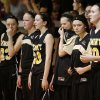 Members of the Cement girls basketball team stand before the start of a girls basketball game in Cement, Okla., Wednesday, January 30, 2014. Seth Martin, 15, collapsed during Tuesday\'s game and later died at the hospital. Photo by Bryan Terry, The Oklahoman