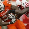 OSU\'s Kendall Hunter fights off Nebraska\'s P.J. Smith during the college football game between the Oklahoma State Cowboys (OSU) and the Nebraska Huskers (NU) at Boone Pickens Stadium in Stillwater, Okla., Saturday, Oct. 23, 2010. Photo by Bryan Terry, The Oklahoman