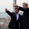 U.S. Secretary of State John Kerry, right, and his Turkish counterpart Ahmet Davutoglu point toward the Bosporus before a working lunch in Istanbul, Turkey, Sunday, April 21, 2013. Wrapping up a 24-hour visit to Istanbul, Kerry on Sunday sought to cement and speed up an improvement in relations between Turkey and Israel as well as explore new ways to relaunch Mideast peace efforts. President Barack Obama has made both issues foreign policy priorities for his second term and Kerry was pushing them in meetings with Abbas and Turkish Foreign Minister Ahmet Davutoglu.(AP Photo/Hakan Goktepe, Pool)
