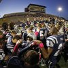 Photo -  The Edmond North team prays before a football game between Edmond North and Moore at Wantland Stadium in Edmond. Photo by Bryan Terry, The Oklahoman Archives  <strong>BRYAN TERRY -   </strong>