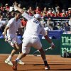 Photo - Britain's Dominic Inglot returns a shot from the United State team as his teammate Colin Fleming looks on during a doubles match at the Davis Cup tennis matches, Saturday Feb. 1, 2014, in San Diego. (AP Photo/Lenny Ignelzi)