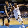 Oklahoma City\'s Serge Ibaka (9) and Memphis\' Courtney Lee (5) chase the ball during an NBA basketball game between the Memphis Grizzlies and the Oklahoma City Thunder at Chesapeake Energy Arena in Oklahoma City, Friday, Feb. 28, 2014. Photo by Nate Billings, The Oklahoman