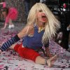 Photo -   Designer Betsey Johnson goes into a split after doing a cartwheel on the runway after the Betsey Johnson Spring 2013 collection show during Fashion Week, Tuesday, Sept. 11, 2012, in New York. (AP Photo/Jason DeCrow)