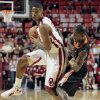 Oklahoma\'s Cameron Clark (21) tries to get past Idaho State\'s Sherrod Baldwin (5) as the University of Oklahoma Sooner men\'s basketball team defeats the Idaho State Bengals 78-74 at the Lloyd Noble Center on Friday, Nov. 11, 2011, in Norman, Okla. Photo by Steve Sisney, The Oklahoman