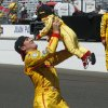Photo - Ryan Hunter-Reay lifts his son, Ryden, after Hunter-Reay won the 98th running of the Indianapolis 500 IndyCar auto race at the Indianapolis Motor Speedway in Indianapolis, Sunday, May 25, 2014. (AP Photo/Tom Strattman)