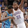 Oklahoma City Thunder\'s Daniel Orton (33) defends on New Orleans Hornets\' Al-Farouq Aminu (0) during the NBA basketball game between the Oklahoma CIty Thunder and the New Orleans Hornets at the Chesapeake Energy Arena on Wednesday, Dec. 12, 2012, in Oklahoma City, Okla. Photo by Chris Landsberger, The Oklahoman