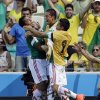 Mexico\'s Giovani dos Santos, left, celebrates after scoring the opening goal during the World Cup round of 16 soccer match between the Netherlands and Mexico at the Arena Castelao in Fortaleza, Brazil, Sunday, June 29, 2014. (AP Photo/Natacha Pisarenko)