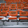 Snow covers stadium seats before the Bedlam college football game between the Oklahoma State University Cowboys (OSU) and the University of Oklahoma Sooners (OU) at Boone Pickens Stadium in Stillwater, Okla., Saturday, Dec. 7, 2013. Photo by Bryan Terry, The Oklahoman