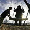Brothers DeShawn Ford, 11, left, and Tyres Blackshire, 7, play on a swing and enjoy unseasonably warm temperatures at Joe B. Barnes Regional Park in Midwest City Thursday afternoon, Jan. 22, 2009. The boys attend Telstar Elementary School. The playground was full of adults and children who came to participate in outdoor recreational activities on a January afternnon when temperatures soared into the 70s. BY JIM BECKEL, THE OKLAHOMAN