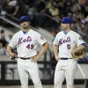 Photo - New York Mets starting pitcher Jonathon Niese (49) and third baseman David Wright (5) react as they await the arrival of  manager Terry Collins to remove Niese from the game after he gave up two runs to the Atlanta Braves in the eighth inning of a baseball game at Citi Field on Thursday, Aug. 28, 2014, in New York. The Braves won 6-1. (AP Photo/Kathy Kmonicek)