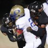 Oologah\'s John Vansingel is brought down by Douglass\' Erik King, left, and Jas\'Sen Stoner during a high school playoff football game in Oklahoma City, Friday, Nov. 19, 2010. Photo by Bryan Terry, The Oklahoman
