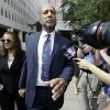 Photo - Former New Orleans Mayor Ray Nagin leaves federal court, with his wife, Seletha Nagin, left, after being sentenced in New Orleans, Wednesday, July 9, 2014. Nagin was sentenced to 10 years in prison for bribery, money laundering and other corruption that spanned his two terms as mayor, including the chaotic years after Hurricane Katrina hit in 2005. He was convicted Feb. 12 of accepting hundreds of thousands of dollars from businessmen who wanted work from the city or Nagin's support for various projects. The bribes came in the form of money, free vacations and truckloads of free granite for his family business. (AP Photo/Gerald Herbert)