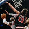 New York Knicks\' Carmelo Anthony, left, attempts a shot as Chicago Bulls\' Joakim Noah defends during the first quarter of an NBA basketball game Friday, Jan. 11, 2013, at Madison Square Garden in New York. (AP Photo/Bill Kostroun)