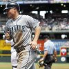 Photo -   Seattle Mariners' Kyle Seager heads back to the dugout after scoring on a single by Justin Smoak against the Colorado Rockies in the first inning of an interleague baseball game in Denver on Sunday, May 20, 2012. (AP Photo/David Zalubowski)