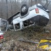 Photo - Occupants escaped serious injury when their SUV overturned Thursday, Dec. 5, 2013, near Norfork, Ark. A mix of rain,sleet and snow moved through northern Arkansas Thursday. More is expected Friday. (AP Photo/The Baxter Bulletin, Kevin Pieper)