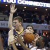 Indiana Pacers\' Tyler Hansbrough, left, and Charlotte Bobcats\' Ben Gordon, right, wrestle for control of a rebound during the first half of an NBA basketball game in Charlotte, N.C., Friday, Nov. 2, 2012. (AP Photo/Chuck Burton)