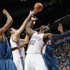 Washington\'s Rashard Lewis (9) and Oklahoma City\'s Nenad Krstic (12) and Jeff Green (22) try to control the ball during the NBA basketball game between the Washington Wizards and the Oklahoma City Thunder at the Oklahoma City Arena in Oklahoma City, Friday, January 28, 2011. The Thunder won, 124-117, in double overtime. Photo by Nate Billings, The Oklahoman