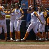 Tennessee\'s Ashley Andrew\'s (22) celebrates with her teammates during a Women\'s College World Series game between Tennessee and Oregon at ASA Hall of Fame Stadium in Oklahoma City, Saturday, June 2, 2012. Photo by Garett Fisbeck, The Oklahoman