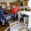 Carol Arnold, left, and her neighbor Beverlee Johannsen carry belongings that Arnold salvaged from her house after it was damaged by surge from Superstorm Sandy on Cedar Bonnet Island, N.J., Saturday, Nov. 3, 2012. Frustration is setting in for some New Jersey residents who are still without power and running low on food. Some residents say too much attention is being paid to the Shore and not enough to working people who are hurting.(AP Photo/Patrick Semansky) ORG XMIT: NJPS114