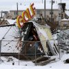 Superstorm Sandy debris from a miniature golf course sits under snow at Jenkinson\'s Boardwalk, Thursday, Nov. 8, 2012, in Point Pleasant, N.J. The area was hit by a nor\'easter Wednesday the second storm in two weeks. (AP Photo/Julio Cortez) ORG XMIT: NJJC105