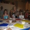 Respect Diversity Artist and Educator Jo Anne Alexander works with Brooke Eisenhauer and Carley Martin of the Summer Blast Camp at the MAC in Mitch Park in Edmond preparing individual kites for a special Respect Diversity Foundation project. Community Photo By: Nina Hager Submitted By: Nina,