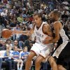 Oklahoma City\'s Thabo Sefolosha (2) drives past San Antonio\'s Tony Parker (9) during the NBA game between Oklahoma City and San Antonio, Tuesday April 7, 2009, at the Ford Center in Oklahoma CIty. Photo by Sarah Phipps, The Oklahoma