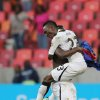 Ghana\'s Harrison Afful, front, celebrates with captain Ghana\'s Asamoah Gyan after winning their quarter final African Cup of Nations soccer match against Cape Verde at the Nelson Mandela Bay Stadium in Port Elizabeth, South Africa, Saturday Feb. 2, 2013. (AP Photo/Themba Hadebe)