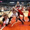 Photo - Chicago Bulls forward Taj Gibson (22) keeps the ball from going out of bounds as Carlos Boozer (5), Washington Wizards center Marcin Gortat (4) and Trevor Booker (35) stand near during the first half of Game 5 in an opening-round NBA basketball playoff series Tuesday, April 29, 2014, in Chicago. (AP Photo/Charles Rex Arbogast)