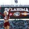 A member of the Oklahoma cheer team performs before the Bedlam college football game between the University of Oklahoma Sooners (OU) and the Oklahoma State University Cowboys (OSU) at the Gaylord Family-Oklahoma Memorial Stadium on Saturday, Nov. 28, 2009, in Norman, Okla. Photo by Chris Landsberger, The Oklahoman