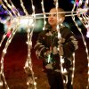 T.J. Sanders, 3, plays inside a light decoration during a tree lighting ceremony at Shannon Miller Park in Edmond, Okla., Thursday, December 2, 2010. Photo by Bryan Terry, The Oklahoman