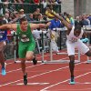 Photo - Oregon's Devon Allen, front left, and Texas A&M's Wayne Davis II reach for the finish line during the men's 110-meter hurdles at the NCAA track and field championships onSaturday, June 14, 2014, in Eugene, Ore. Allen came in first place and Davis came in third. (AP Photo/Rick Bowmer)