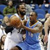 Photo - Denver Nuggets's Darrell Arthur, right, gets a pass as Minnesota Timberwolves' Ronny Turiaf, of France, defends in the first quarter of an NBA basketball game Wednesday, Feb. 12, 2014, in Minneapolis. (AP Photo/Jim Mone)